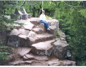 Woman sitting on rock columns